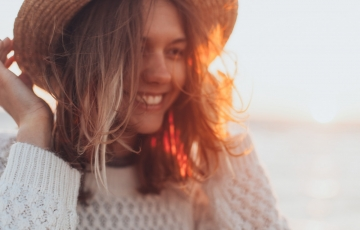 A woman smiling during the golden hour