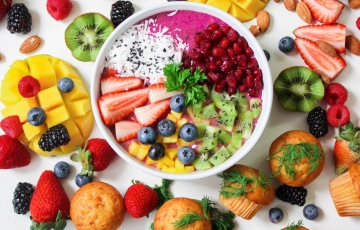 Fresh fruits around a bowl